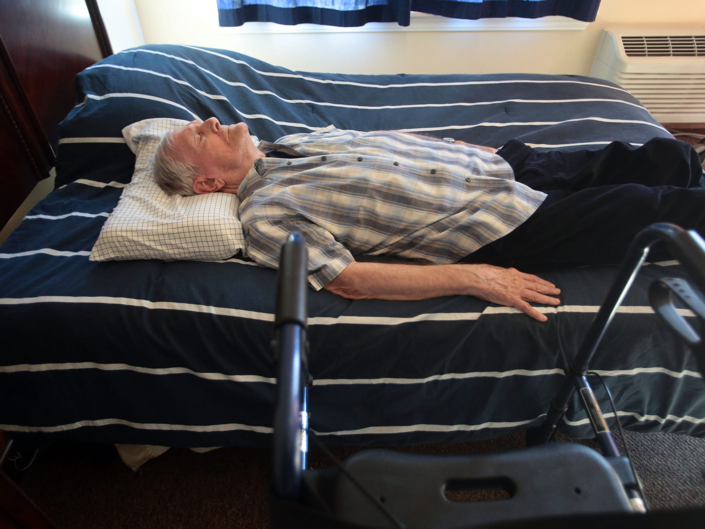 Bruce Lansbury, 86, a retired TV writer and producer is asleep in his room at Caleo Bay Alzheimer's Care Center in La Quinta on Tuesday, February 2, 2016.