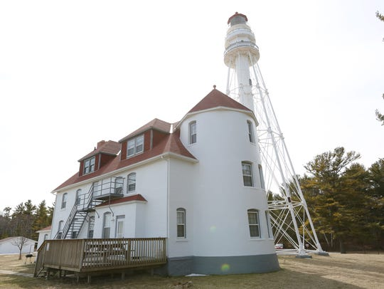 Rawley Point Lighthouse stands 113 feet tall at Point