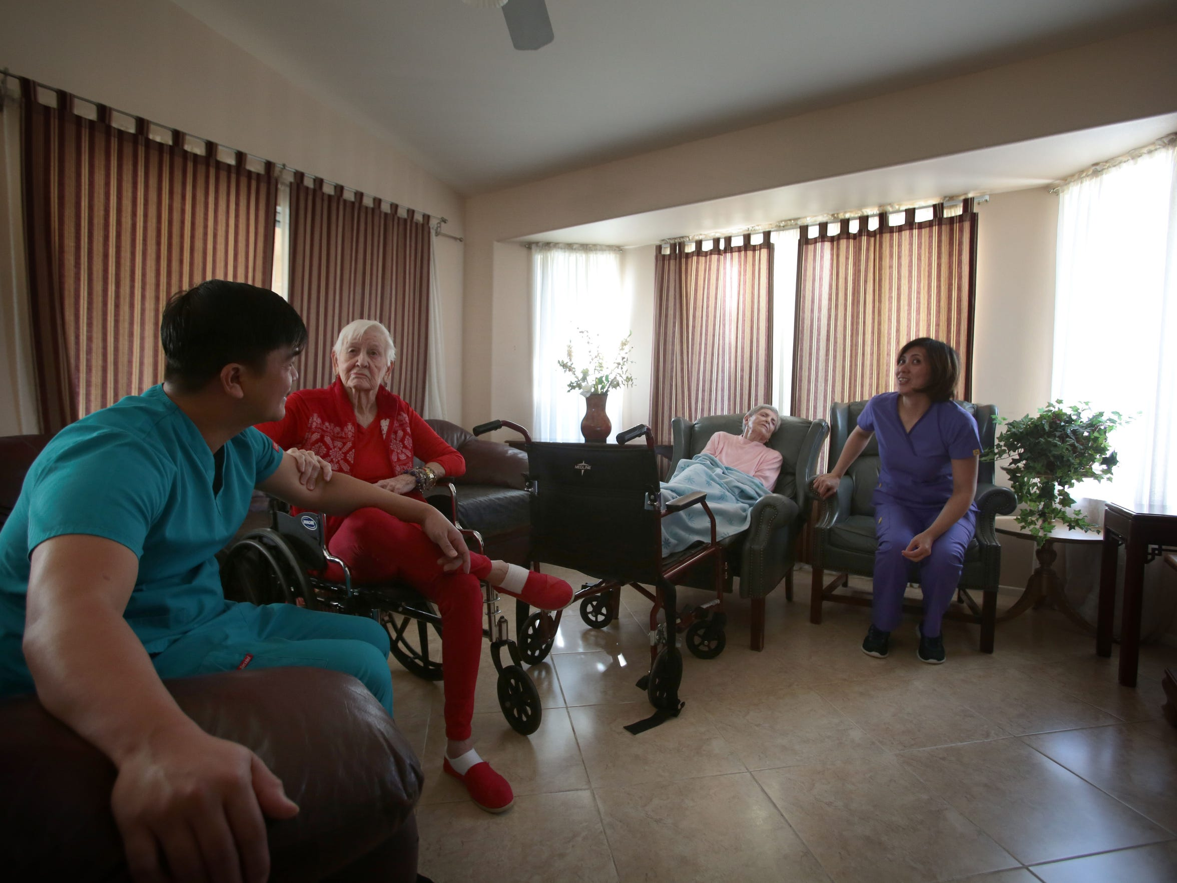 Staff members with residents at a residential assisted living facility in Indio on Friday, February 19, 2016.