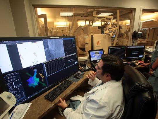 Dr. Hetal R. Bhakta monitors a robotic navigation machine