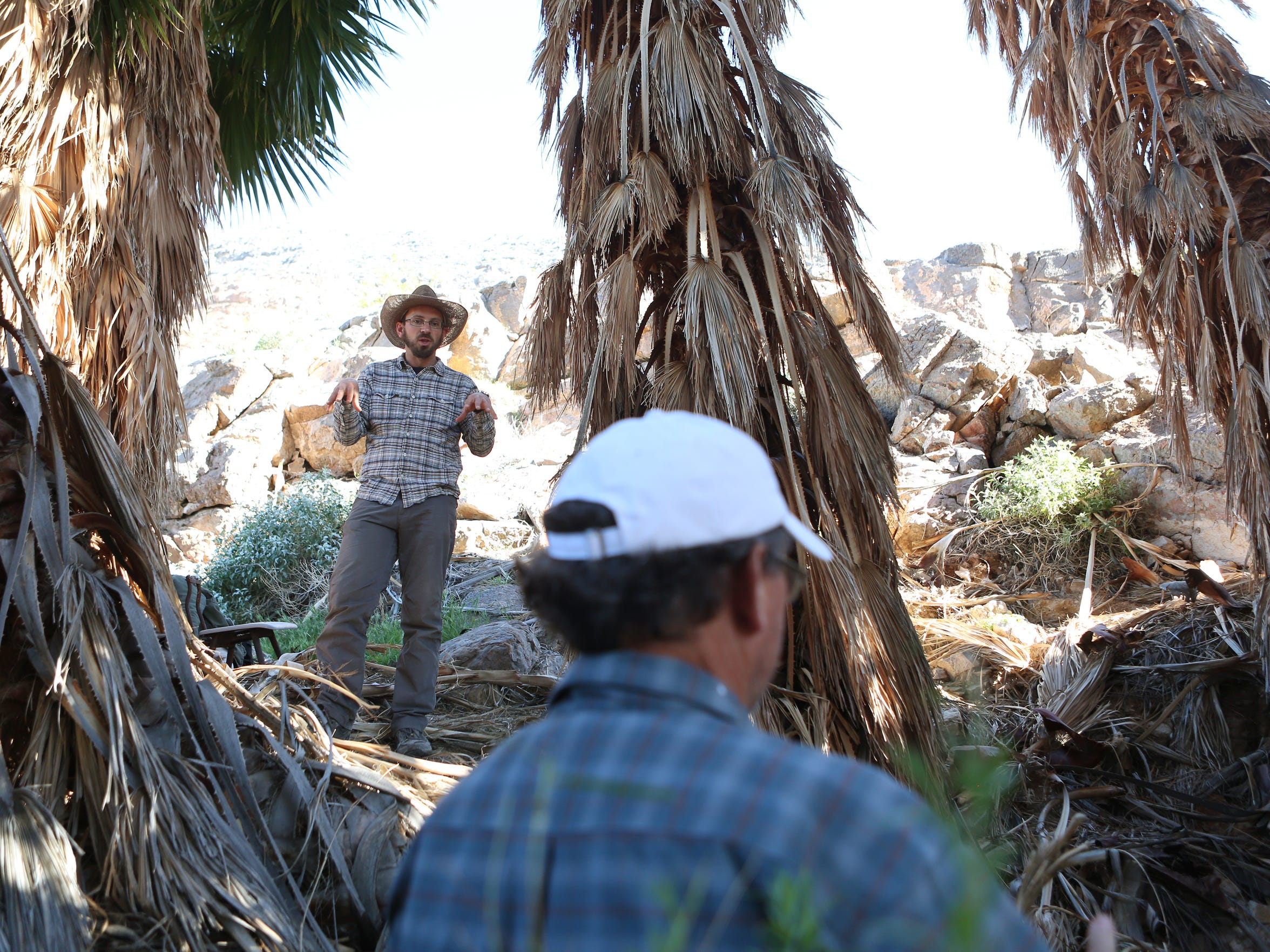 Patrick Donnelly of the Amargosa Conservancy (left) and hydrogeologist Andy Zdon collect data at Chappo Spring as part of a study of springs across the Mojave Desert.