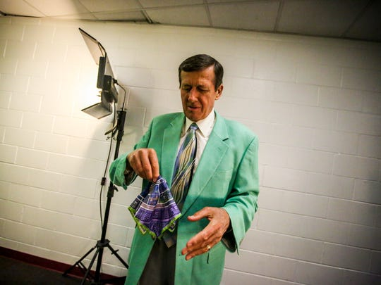 Craig fixes his pocket square before heading out onto the court for work. Craig Sager, the eccentric TNT/TBS NBA sideline reporter began his broadcast career with WINK-TV in Fort Myers in the mid-1970s. HeÕs now renewing his very public battle against leukemia while still working NBA games. He worked the Chicago Bulls at Miami Heat game on Thursday, April 7, 2016.