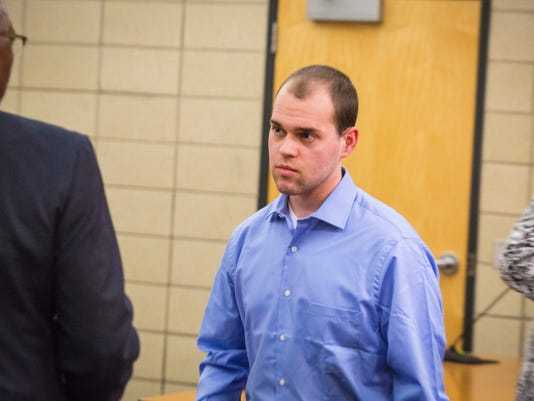 Alexander Kozak, 22, makes an appearance with his attorney Alfredo Parrish at the Story County Courthouse for a hearing Monday April 11, 2016, in Nevada, Iowa. He has been accused of shooting and killing 20-year-old Andrea Farrington in the Coral Ridge Ma