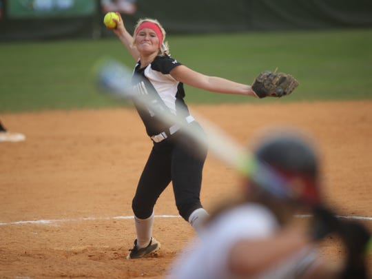 Chiles' Shayne O'Connell fires a pitch as part of a