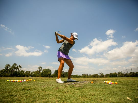 Estero's Laura DeMarco practices on the driving range Wednesday afternoon at Cypress Lake Country Club as she gears up to play in Chico's Patty Berg Memorial Golf Tournament. DeMarco, is a Canadian who lives in Estero.