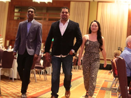 La Quinta track athlete Koty Burton and Palm Desert golfer Jiyoon Jang and former Oscar Lua attend the Boys and Girls Clubs of the Coachella Valley Sports Heroes Luncheon II on Thursday April 14, 2016 at the Hyatt Regency Indian Wells Resort.