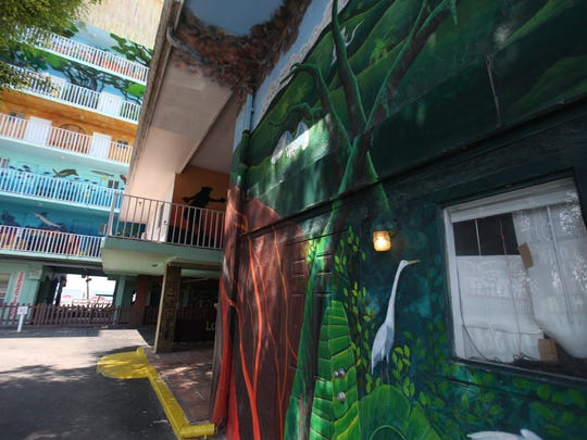 Seen from the south side, the Lani Kai portico is splashed with scenes of Southwest Florida wildlife by local artist, Alan Mishaga, who's been painting the iconic hotel on Fort Myers beach for 20 years.