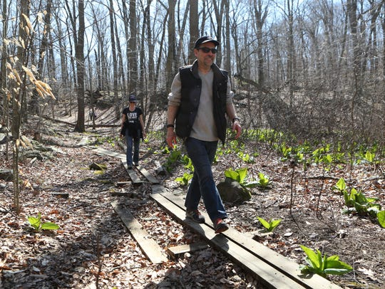 Walkers enjoy the trails at the Cranberry Lake Preserve