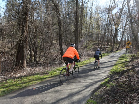 Cyclists enjoy the paths at the Tarrytown Lakes Park in Tarrytown, April 16, 2016.