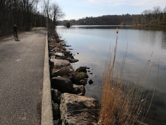 Cyclists enjoy the paths at the Tarrytown Lakes Park
