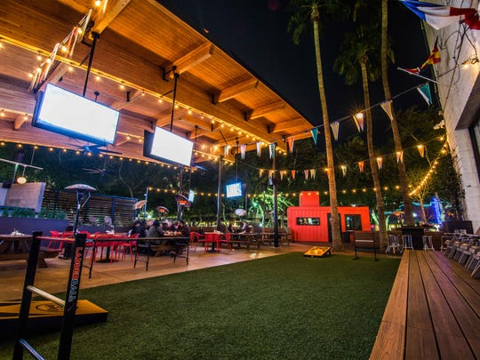Plenty of seating, games and televisions make the spacious patio at Pedal Haus appealing