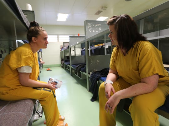Krystal Jennings, left, and Jude Deason, right, talk at Louisville Metro Corrections jail. Both worry about the impact incarceration will have on their children.