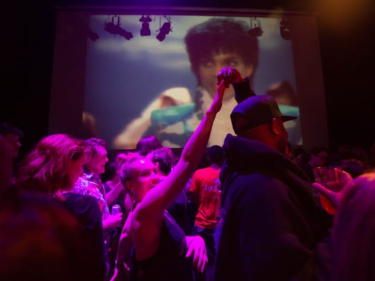 A crowd pays tribute to Prince inside First Ave where