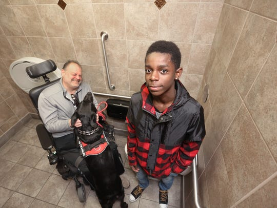 Jim Kroening, left, a multiple sclerosis patient, and