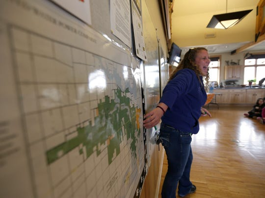 Pam Resech, a wildlife educator at the Mead Wildlife Area, laughs while showing off a map of the property, being the largest continuous wildlife area in the state of Wisconsin, on Earth Day April 22, 2016.