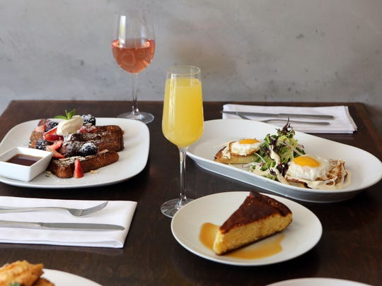 """The French toast with almonds, berries and crme fra""""che and the ham and goat cheese crepes with fried eggs, at Roost Restaurant in Sparkill."""