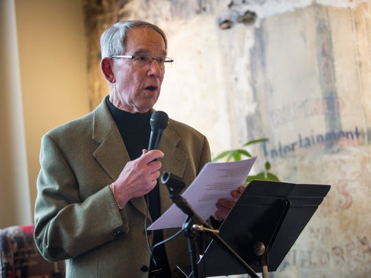 Port Huron poet Art Smith reads during the Times Herald Michigan Poetry Night Thursday, April 28, 2016 at the Exquisite Corpse Coffee House in Port Huron.