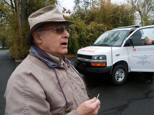 Allan Rubin of Chestnut Ridge stands next to an ambulance