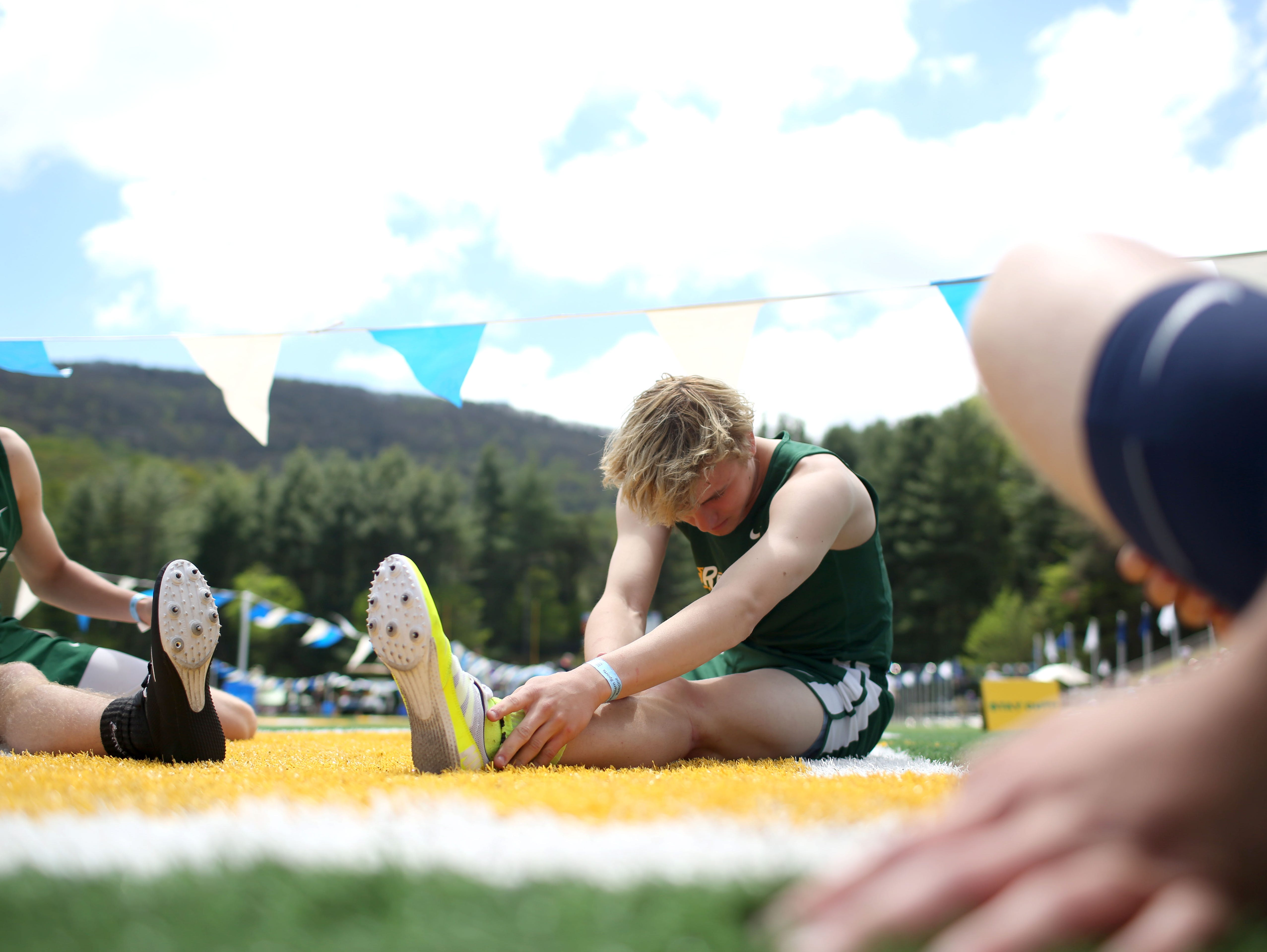 Athletes stretch before a race at last month's Blue Ridge Classic.