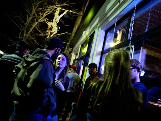 Music fans crowd the sidewalks of Winooski during the first night of the Waking Windows festival Friday.