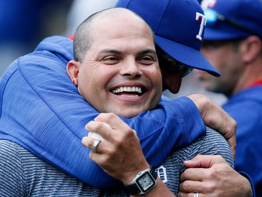 Former Detroit Tiger and Texas Ranger Ivan Rodriguez receives a hug from Texas Rangers manager Jeff Banister after Rodriguez was honored before their baseball game at Comerica Park Saturday, May 7, 2016, in Detroit.