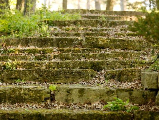 Rock stairs lead visitors toward the limestone rock