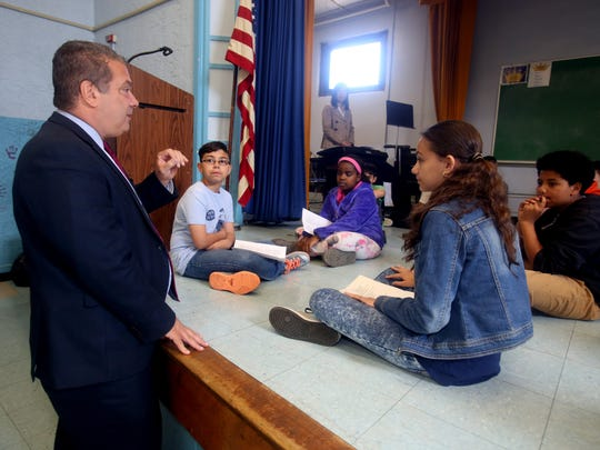 Yonkers Mayor Mike Spano speaks with students in a music class during a tour of School 22 on Nepperhan Avenue. The music class is held in a room that doubles as a cafeteria and auditorium.