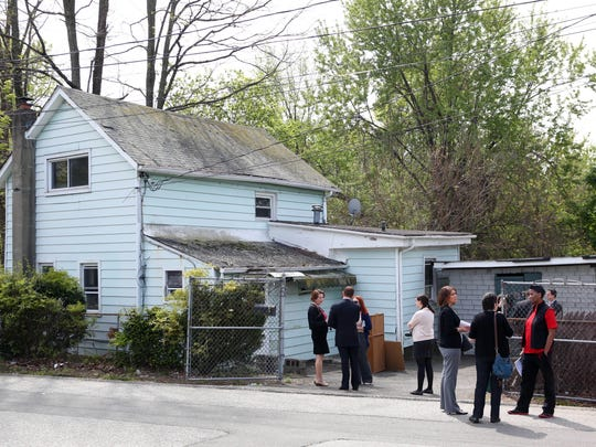 Senators Jeff Klein and David Carlucci called for new legislation to monitor bank-owned homes and zombie properties during a press conference in front of a zombie property in Spring Valley, May 11, 2016.