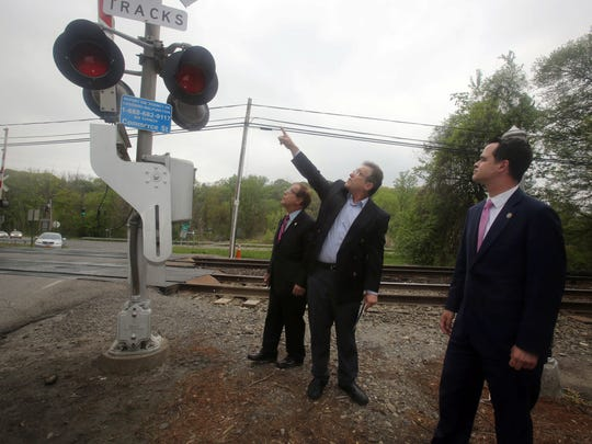Assemblyman Tom Abinanti, left, and State Sen. David Carlucci, listen as Alan Brody, husband of Ellen Brody, points to what he believes are safety deficiencies at the Metro-North railroad crossing at Commerce Street in Valhalla May 13, 2016. Ellen Brody and five others were killed when the vehicle she was driving was struck by a Metro-North train at the crossing in February of 2015. Abinanti and Carlucci are trying to get legislation passed that they hope will improve railroad crossing safety.