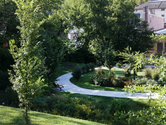 A rain garden and walking path off Queen City Avenue