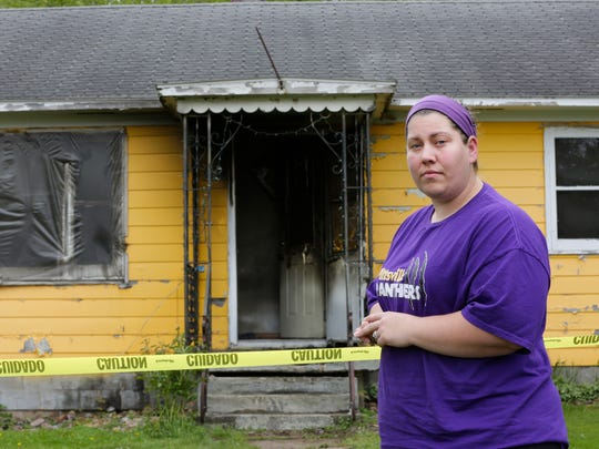 Shannon Millard, a resident of Pittsville, stands in front of the house of her neighbor, Robert Tritz, who she pulled out of his burning home earlier in the day on May 11, 2016. Fire crews on scene credited Millard with saving Tritz's life. Millard now is collecting donations to help Tritz.