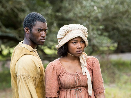 Kunta (Malachi Kirby) and his teenage daughter, Kizzy (Emyri Crutchfield).