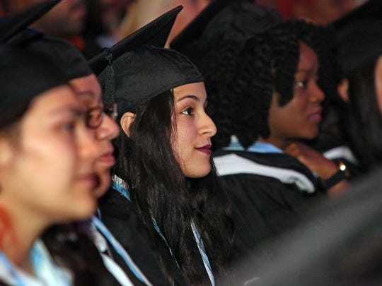 Bianca Jeannot listens to a speaker during commencement