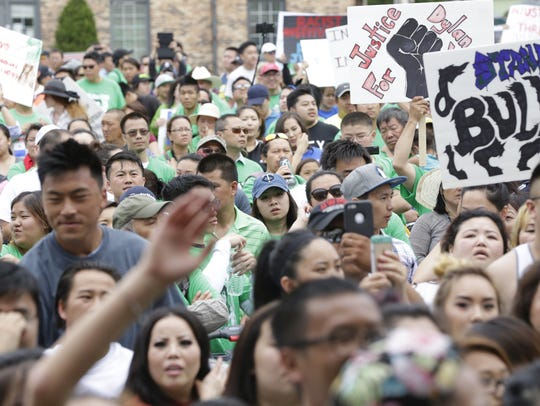 Hundreds of demonstrators rally Tuesday afternoon at
