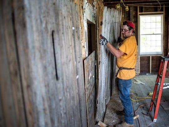 Eddy Schuyler works on the interior Saturday, June