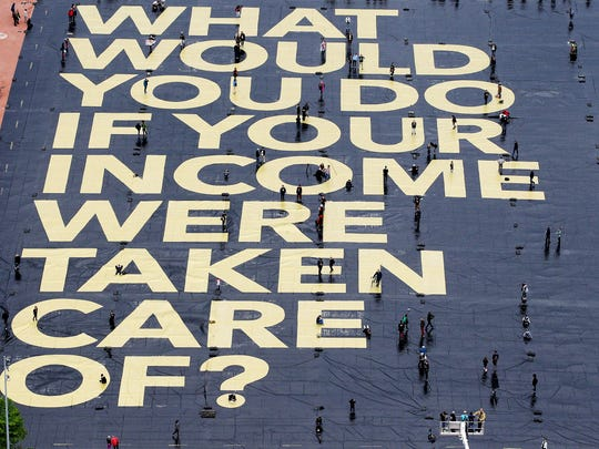 "A huge poster in Geneva, Switzerland, in May 2016 read: ""What would you do if your income were taken care of?"""