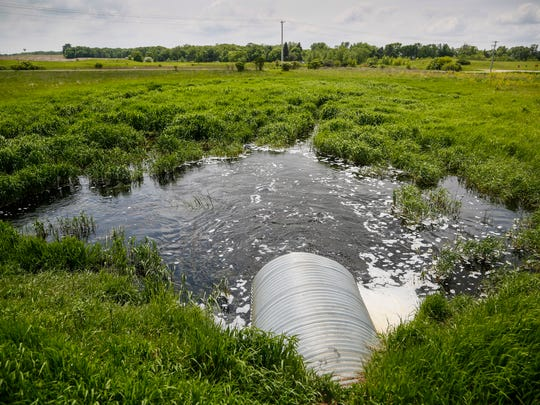 A wetland sits near at Center Lake in Spirit Lake Monday,