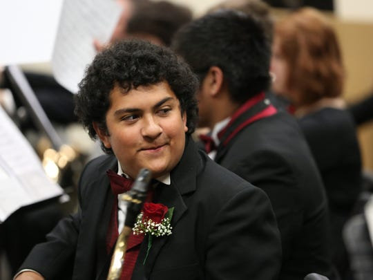 Senior Roberto Ramirez and fellow North Salem musicians warm up during the OSAA 6A Band State Championships on Saturday, May 14, 2016, at the LaSells Stewart Center at Oregon State University in Corvallis.