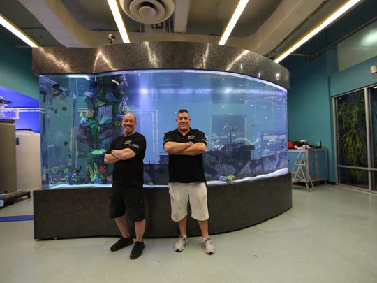 "Wayde King (right) and Brett Raymer of ""Tanked"" pose with their aquarium at the Imaginarium."