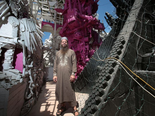 Kenny Irwin Jr. amongst his Robolights art display in the back of his Palm Springs home on Thursday, June 9, 2016. Inspectors checked the site for code violation earlier in the day.