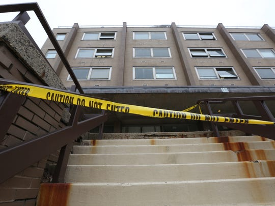 The aging Sain Building's front steps are blocked off with caution tape because of cracked steps.