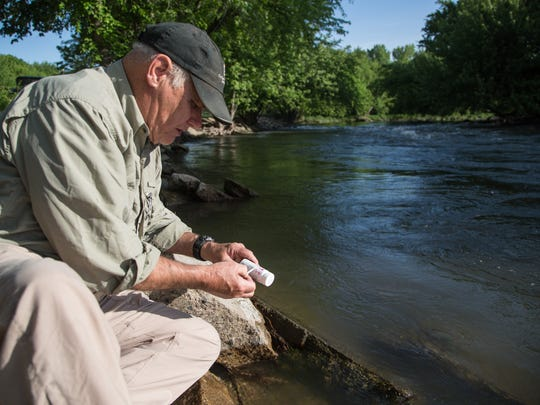 Retired environmental science teacher Ray Harden tests Nitrate levels in the Raccoon River Saturday, May 21, 2016.