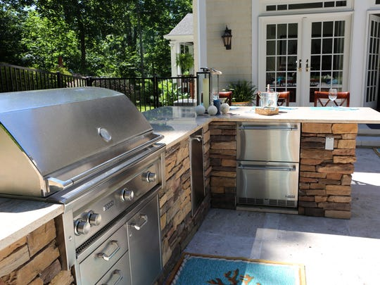 A new trend that home buyers are looking for is having an outdoor oasis that resembles the comfort of the indoors. The outdoor kitchen with upscale appliances and a granite countertop in a Westchester backyard, June 14, 2016.