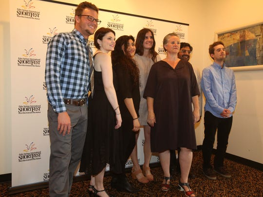 Helen du Toit, center, with staff of the Palm International ShortFest pose for photos at the Camelot Theatre at the opening night of the Palm Springs International ShortFest on Tuesday, June 21, 2016 in Palm Springs.