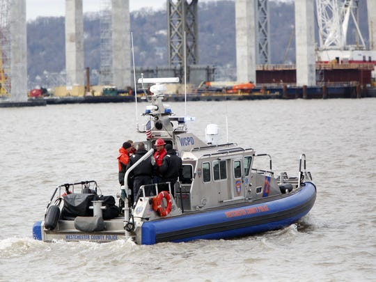 A Westchester County Police boat goes out towards the