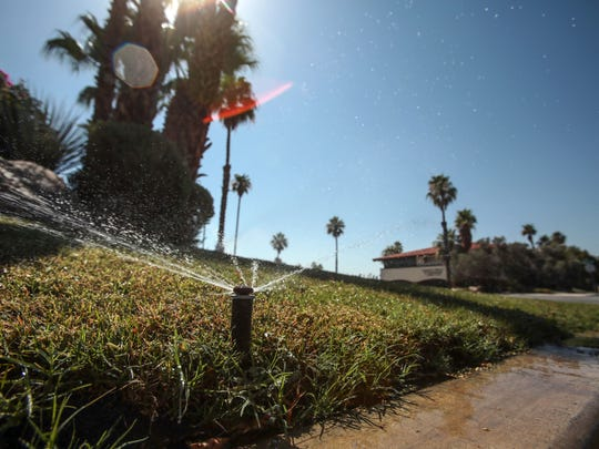 Sprinklers water the grass at the Renaissance Palm Springs on June 23, 2016.