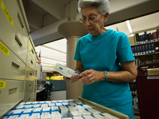 Founder of the Doña Ana County Genealogical Society Frankie Lerner looks through microfilm of the Las Cruces Sun-News from 1994-2000 at Branigan Library.