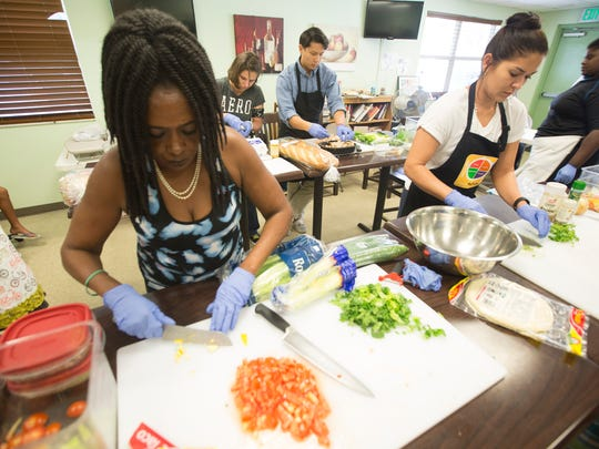Francine Jackson, 58,  a Pine Manor resident takes part in a culinary school at the Pine Manor Community Center on Tuesday 6/28/2016.  She is hoping to find a job in the restuarant industry after she graduates.  Leaders of the community center attribute some of the drop in crime to a community garden and the school.