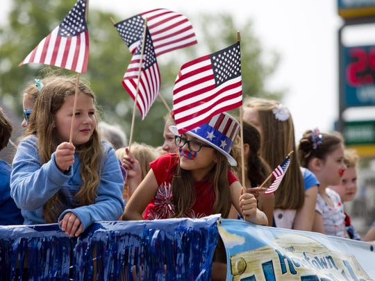Kids wave flags on a float for Lexington Vacation Bible School during Saturday?s Fourth of July parade in Lexington. Kids wave flags on a float for Lexington Vacation Bible School during the 2015 Fourth of July parade in Lexington.