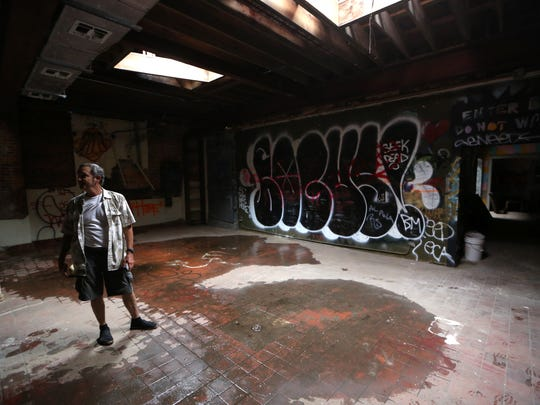 Dean Minardi stands inside the old Coca-Cola building on the corner of St. Michaels and All Saints Streets, where he is hoping to remodel and re-open as a vodka distillery.